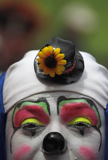 A clown poses for a picture during a parade to inaugurate the 5th Annual Clowns' Convention in Guatemala City. (Jorge Dan Lopez/Reuters photo)