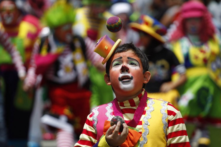 A clown juggles during a parade to inaugurate the 5th Annual Clowns' Convention in Guatemala City. (Jorge Dan Lopez/Reuters photo)