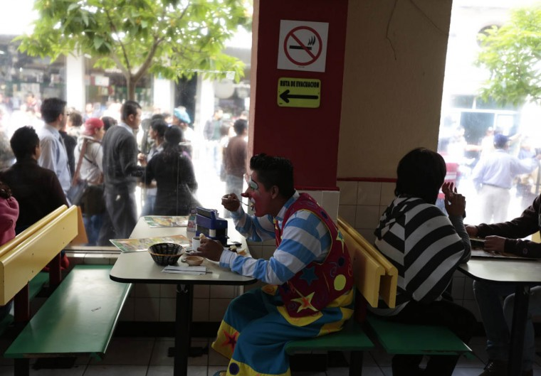 A clown has his breakfast before participating in a parade to inaugurate the 5th Annual Clowns' Convention. (Jorge Dan Lopez/Reuters photo)