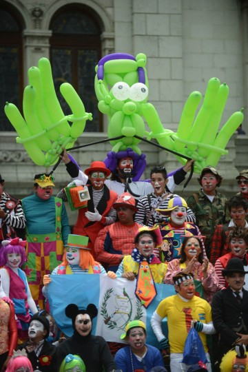 Clowns pose during a parade in the historical center of Guatemala City in the framework of the 5th Latin American Clown Congress. (Johan Ordonez/AFP/Getty Images)