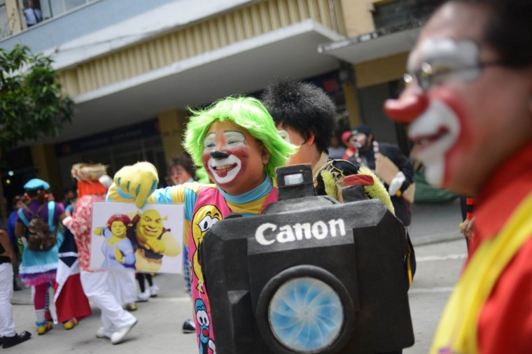 A clown poses during a parade in the historical center of Guatemala City in the framework of the 5th Latin American Clown Congress on July 23, 2013. (Johan Ordonez/AFP/Getty Images)