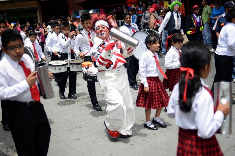 A clown performs during a parade in the historical center of Guatemala City in the framework of the 5th Latin American Clown Congress. (Johan Ordonez/AFP/Getty Images)