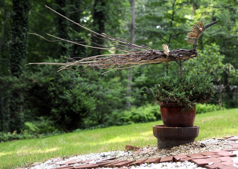 This is a wooden compass made with tree branches and wooden clothespins. (Barbara Haddock Taylor/Baltimore Sun)
