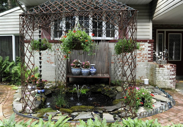 A view of the koi pond includes many art objects. (Barbara Haddock Taylor/Baltimore Sun)
