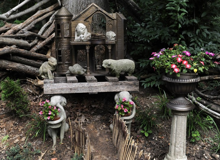 This is a home for damaged garden animals, featuring a painted doll house in the background. (Barbara Haddock Taylor/Baltimore Sun)