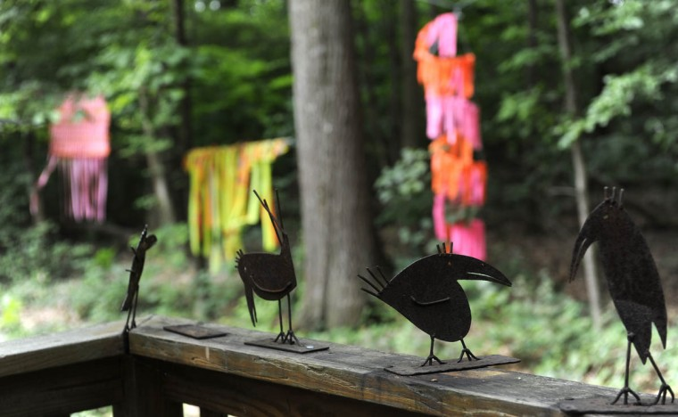 These are metal bird sculptures in the garden of artist Sherrill Cooper. (Barbara Haddock Taylor/Baltimore Sun)