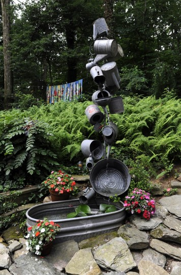 This is a fountain in the garden of artist Sherrill Cooper, who has made sculptures and decorations from found objects. (Barbara Haddock Taylor/Baltimore Sun)