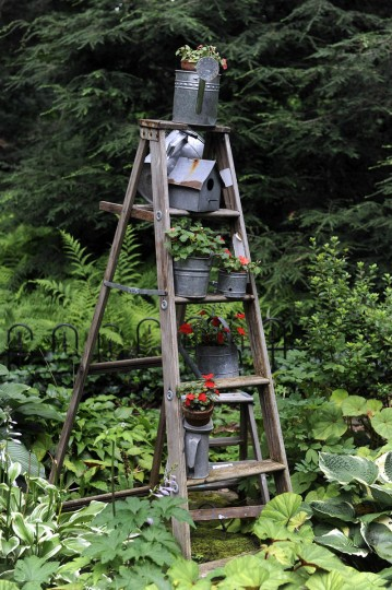This old ladder, decorated with various planters, is in the garden of artist Sherrill Cooper. (Barbara Haddock Taylor/Baltimore Sun)