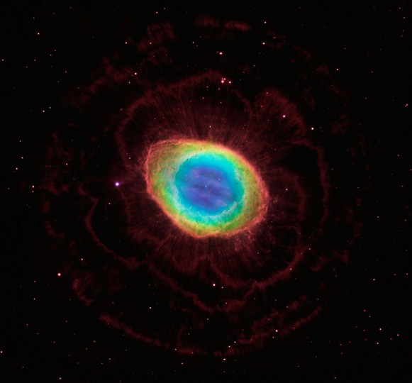 This Hubble photo of the distinctive Ring Nebula reveals a complex structure, which allowed astronomers to construct the most precise 3D model of the glowing gas shroud. Based on the new observations, the Hubble research team suggests that the ring wraps around a blue football-shaped structure that protrudes out of opposite sides of the ring. The nebula is tilted toward Earth so that astronomers see the ring face-on. (Photo courtesy of NASA/ESA)
