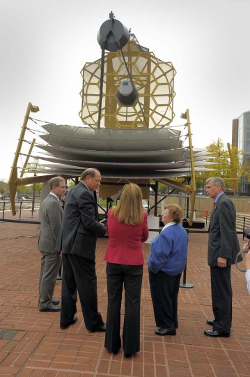 U.S. Senator Barbara A. Mikulski, D-Md.. (in blue, second from right) and other dignitaries listen to Jeff Grant, vice president and general manager of Northrop Grumman Space Technology (second from left) beneath a full scale model of the James Webb Space Telescope at the Maryland Science Center. (Karl Merton Ferron / The Baltimore Sun, 2011)