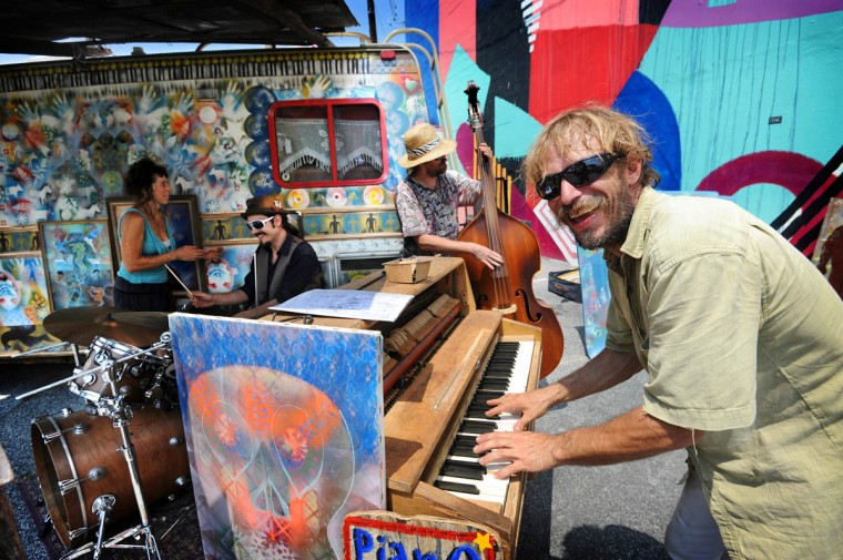 "Jake Hollifield, piano player with the Screaming Js is also curator of the Art V art van. On bass is Jonathan ""JP"" Hess and Mike Gray is the drummer. They are from Ashville, NC, and are part of Artscape's art car show. (Kim Hairston/The Baltimore Sun)"