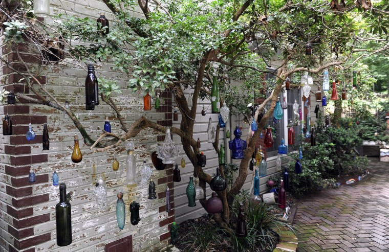 This is a bottle tree in the garden of artist Sherrill Cooper. (Barbara Haddock Taylor/Baltimore Sun)