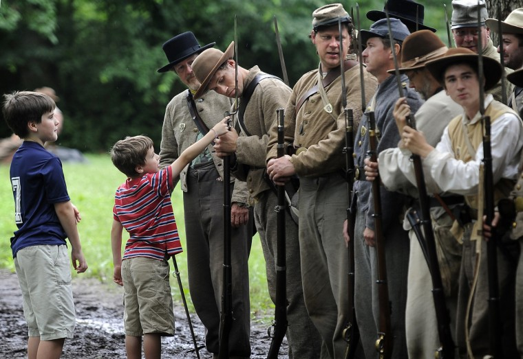 Maxime, left and James Bielaszka-DuVernay of Sparks look at weapons carried by Confederate soldiers at the 150th anniversary of the Battle of Gettysburg. (Barbara Haddock Taylor/Baltimore Sun)