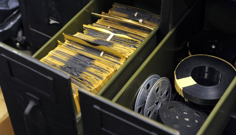 Drawers containing 4 X 5 negatives, left, and film reels, right, are in the office of Timothy G. Hyman. (Barbara Haddock Taylor/Baltimore Sun)