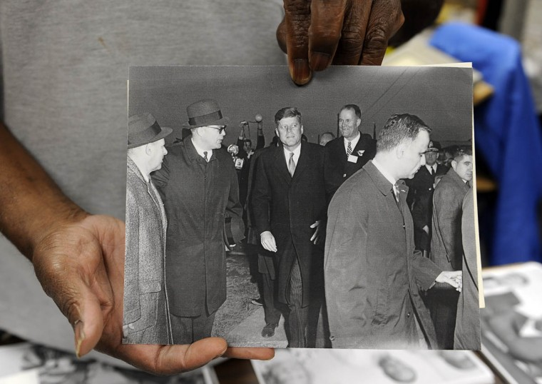 Timothy G. Hyman, holds a photograph he took of President John F. Kennedy at the dedication of Route 95. It was one of Kennedy's last official appearances, and was taken a few days before he was assassinated. (Barbara Haddock Taylor/Baltimore Sun)