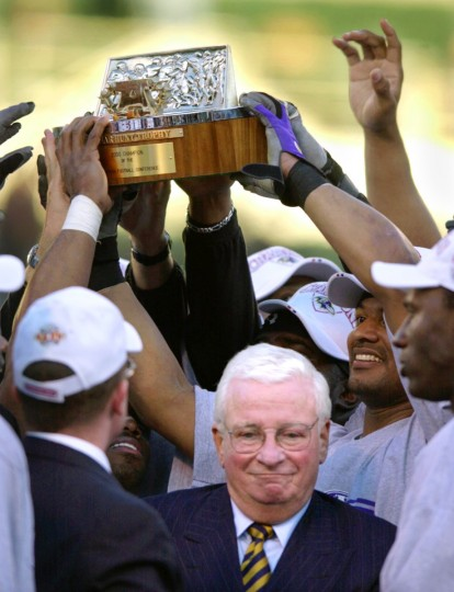 Ravens owner Art Modell smiled as his players lifted the AFC championship trophy following a 16-3 win over the Oakland Raiders on Jan. 14, 2001. (Gene Sweeney, Jr./Baltimore Sun)