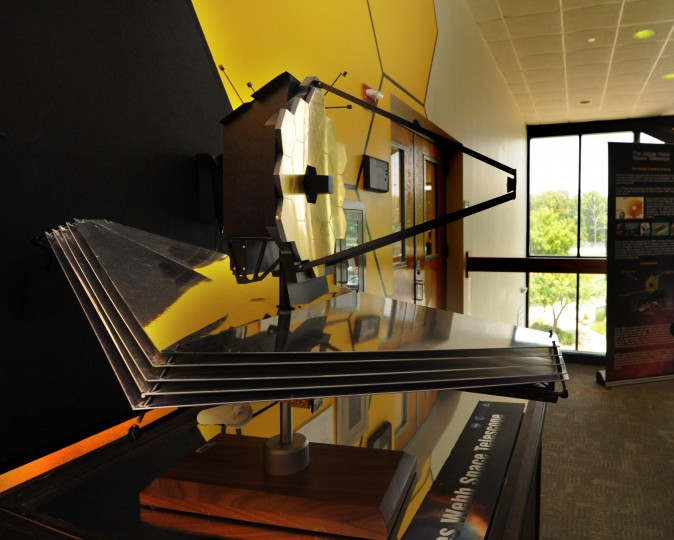 This is a 20th-scale model of the James Webb Space Telescope. The actual telescope is being built in the Building 29 Clean Room of NASA's Goddard Space Flight Center. The five triangular layers beneath the telescope, which are each about the size of a tennis court, are used to cool the telescope. The mirror segments (bronze color) are made of beryllium, a thermally stable material. The primary mirror is made up of 18 segments. (Algerina Perna/Baltimore Sun)