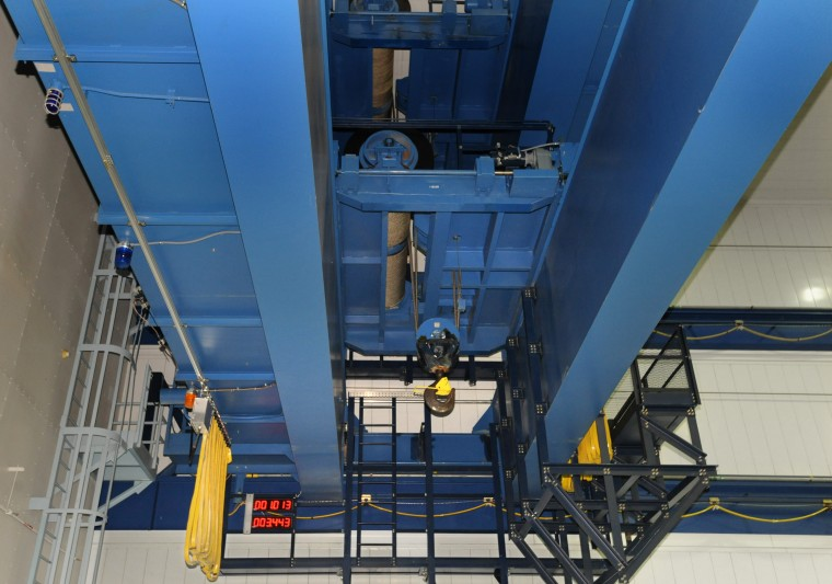 A crane is used to move large pieces of the telescope within the clean room. (Algerina Perna/Baltimore Sun)