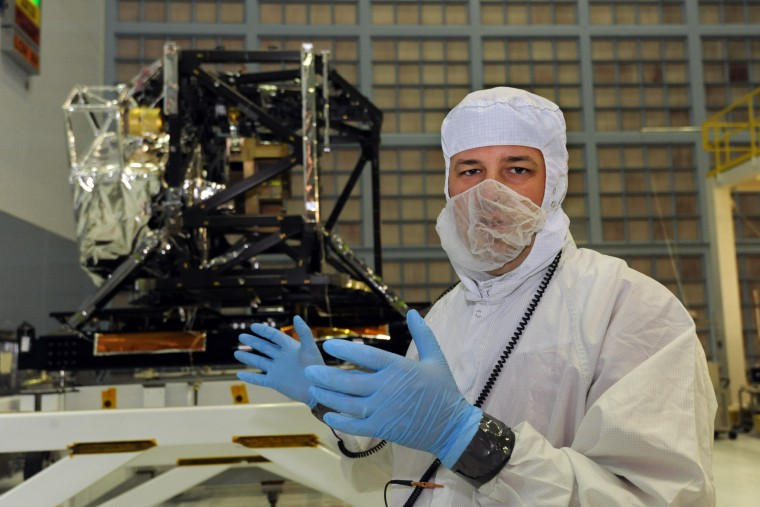 Jason Hylan is lead mechanical engineer for the Integrated Science Instrument Module in the background. The module is part of the James Webb Space Telescope. (Algerina Perna/Baltimore Sun)