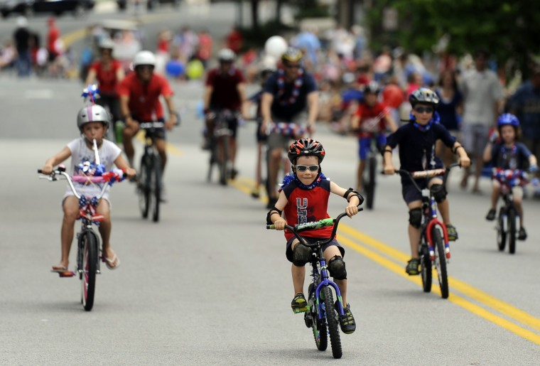 "The ""bike rush"" is the traditional start of the Towson Fourth of July parade. (Barbara Haddock Taylor/Baltimore Sun)"
