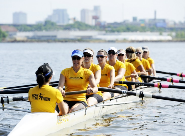 The Row Like A Mother crew sets out on its final practice the day before the regatta, held on Saturday, June 29, at the Baltimore Rowing Club. Coxswain Erica Mah, far left, leads the crew in drills to get them warmed up. Trish Miller, second from the left, is the boat's stroke, who helps set the pace for the rest of the boat. (Jon Sham/BSMG)