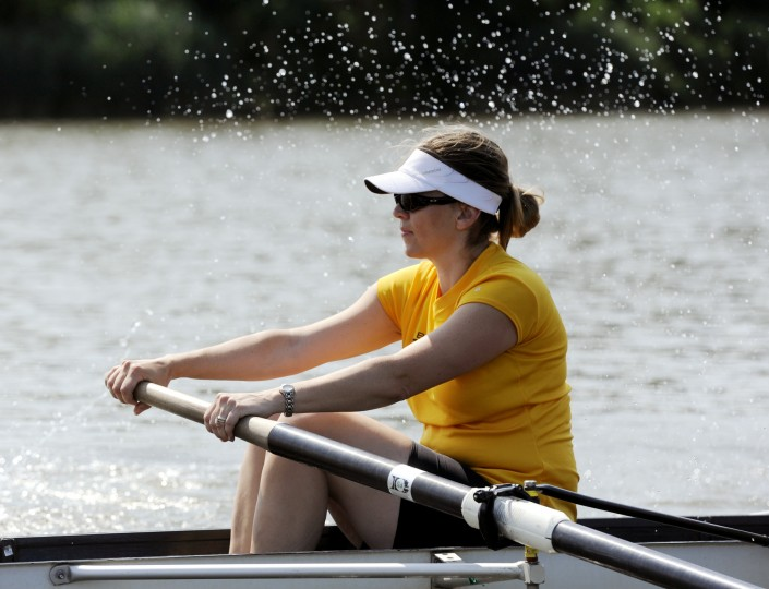 Kathleen Cummings, who sits in the seven seat, or right behind the stroke seat, takes a stroke during a practice drill. (Jon Sham/BSMG)