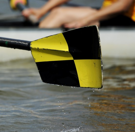 An oar from a rower with the Row Like A Mother crew is lifted out of the water during a practice drill. (Jon Sham/BSMG)