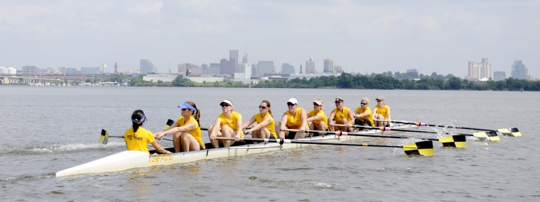 The Baltimore skyline can be seen in the background as the Row Like A Mother crew practices their race starts on Friday, June 28, 2013. Race starts typically involve several fast, short strokes to get the boat moving and then longer strokes to settle into the race. (Jon Sham/BSMG)