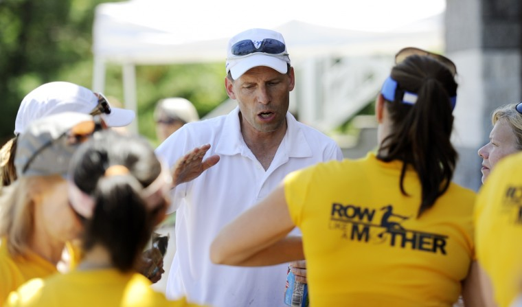 Jeff Ditter, one of the coaches for the Row Like A Mother group and president of the Baltimore Rowing Club, gives the crew some final tips and advice before going out for their race on Saturday, June 29, 2013. (Jon Sham/BSMG)