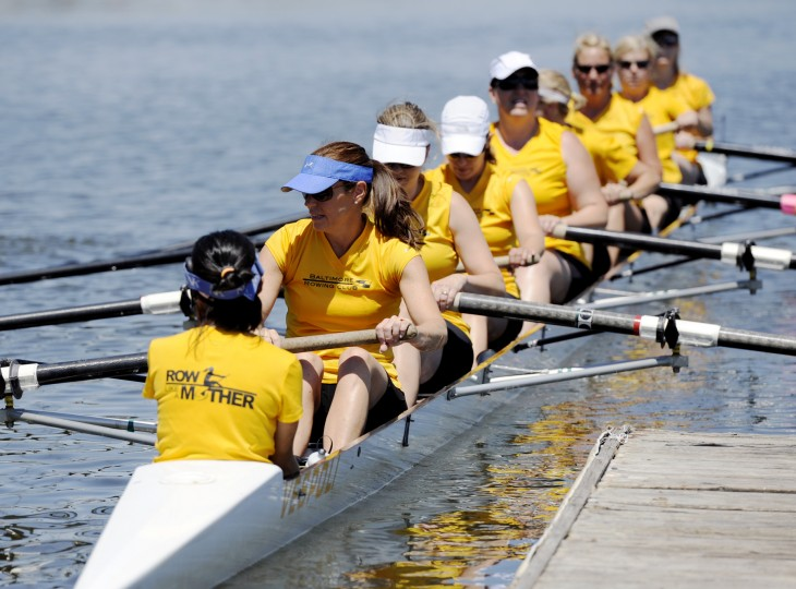 The Row Like A Mother crew pushes off the dock before their race at the Charm City Sprints on Saturday, June 29, 2013. (Jon Sham/BSMG)