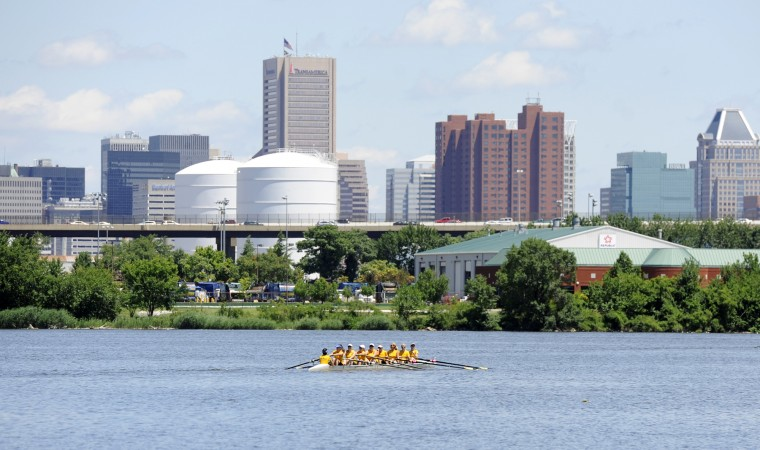 The Row Like A Mother crew warms up before their race at the Charm City Sprints. (Jon Sham/BSMG)