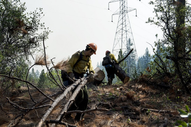 Members to the Horseshoe Meadow Hotshots Chuck Ervin, left, and Ian White prepare a fire break at the Rim Fire in the Stanislaus National Forest in California, Tuesday, August 20, 2013. (Andy Alfaro/Modesto Bee/MCT)