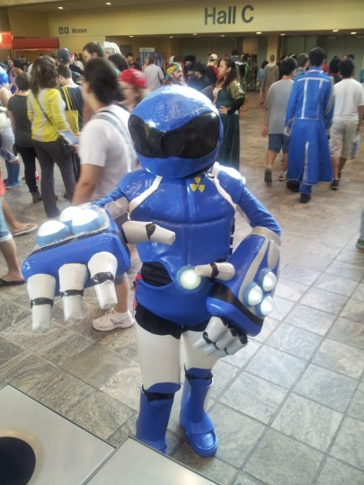 "An Otakon attendee poses as TOM, the mascot for Cartoon Network's ""Toonami"" block. ""Toonami,"" which had its initial run from 1997 to 2008, was the introduction to anime for many convention attendees. (Carrie Wood/For the Darkroom)"