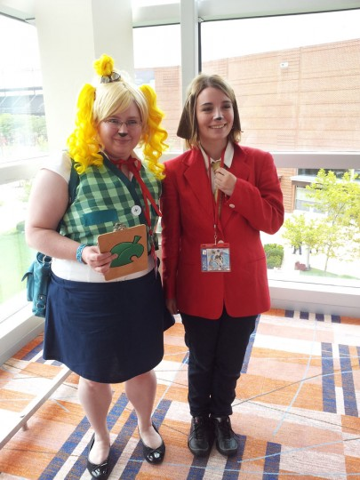 "Nicole Gawel from Wilmington, Del., and Linda Shearer from Harrisburg, Pa., pose in costume at Otakon. The pair dressed as Isabelle and Digby from the recent Nintendo game ""Animal Crossing: New Leaf."" (Carrie Wood/For the Darkroom)"