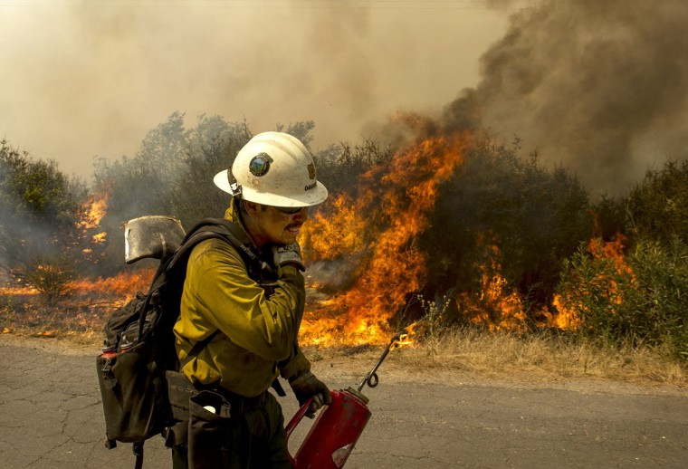 U.S. Forest Service firefighter moves away from a quickly moving section of the Rim Fire in the Stanislaus National Forest in California, Tuesday August 20, 2013. (Andy Alfaro/Modesto Bee/MCT)