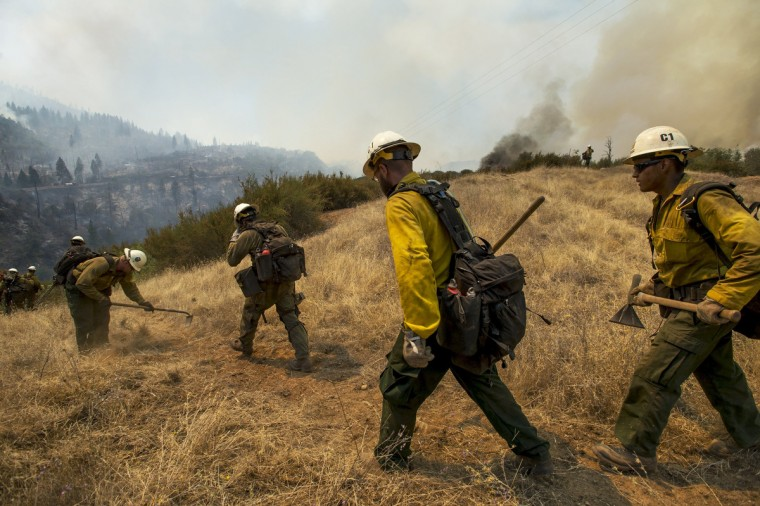 U.S. Forest Service firefighter head out to create a fire break to protect an electrical structure at the Rim Fire in the Stanislaus National Forest in California, Tuesday August 20, 2013. (Andy Alfaro/Modesto Bee/MCT)