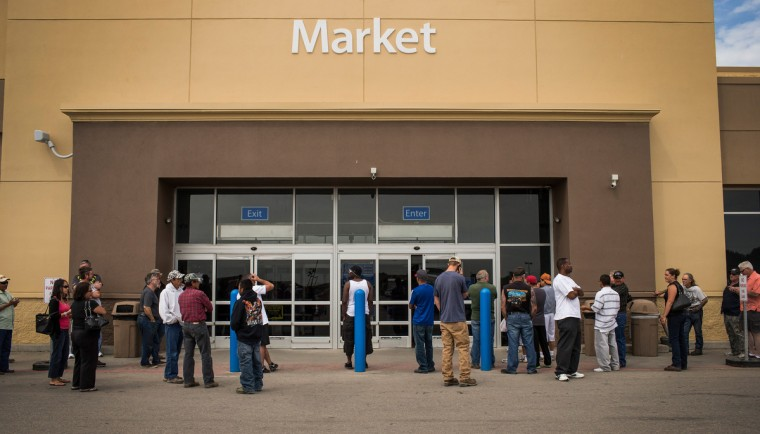 People wait for a Walmart to open on July 28, 2013 in Williston, North Dakota. (Andrew Burton/Getty Images)