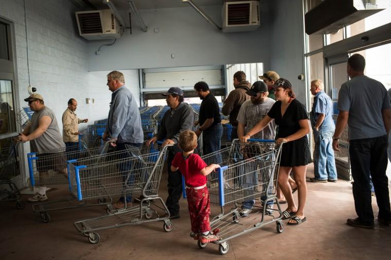 People rush into Walmart after the doors open on July 28, 2013 in Williston, North Dakota. (Andrew Burton/Getty Images)