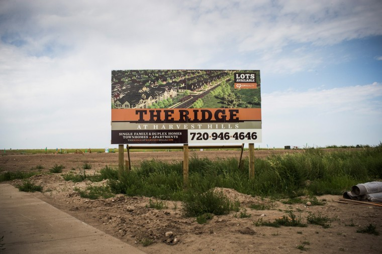 A sign advertises a new neighborhood on July 28, 2013 in Williston, North Dakota. North Dakota has been experiencing an oil boom in recent years, due in part to new drilling techniques including hydraulic fracturing and horizontal drilling. (Andrew Burton/Getty Images)