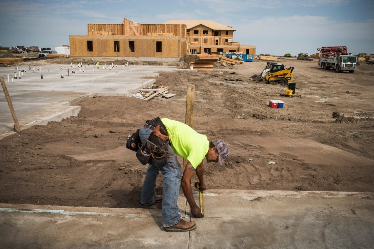Rob Thomasson works at a residential construction site on July 28, 2013 in Watford, North Dakota. (Andrew Burton/Getty Images)