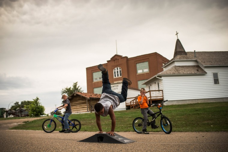 Fielding (L), Zach (C) and Jerome play on the street on July 28, 2013 in Alexander, North Dakota. Fielding's dad, who works as a mechanic and welder, moved the family to North Dakota from Mexico after learning of work being offered. North Dakota has been experiencing an oil boom in recent years, due in part to new drilling techniques including hydraulic fracturing and horizontal drilling. (Andrew Burton/Getty Images)