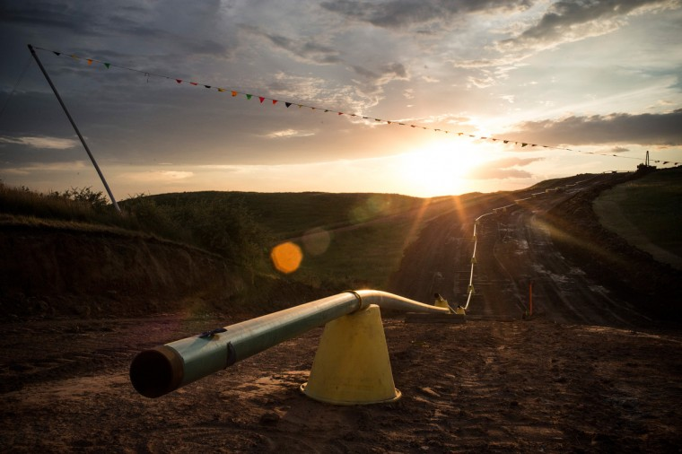 Sections of pipe wait to be welded together and placed into the ground sit in preparation on July 28, 2013 outside Watford City, North Dakota. North Dakota has been experiencing an oil boom in recent years, due in part to new drilling techniques including hydraulic fracturing and horizontal drilling. (Andrew Burton/Getty Images)
