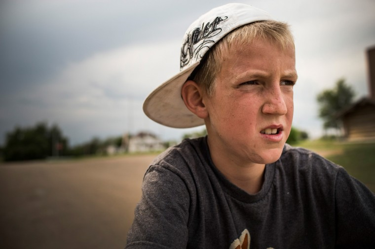 Fielding pauses while riding bikes with his friends on July 28, 2013 in Alexander, North Dakota. Fielding's dad, who works as a mechanic and welder, moved the family to North Dakota from Mexico after learning of work being offered. (Andrew Burton/Getty Images)