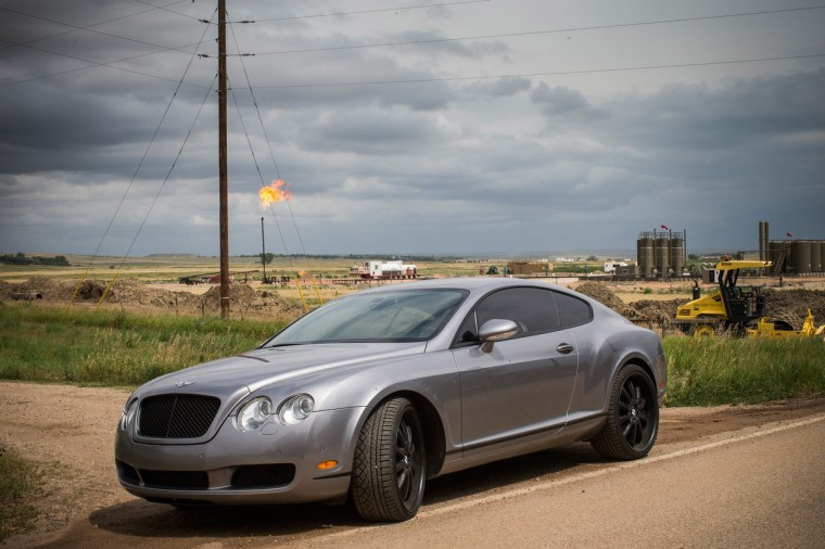 A Bentley Continental GT is parked on the side of the road in Watford City, North Dakota. (Andrew Burton/Getty Images)