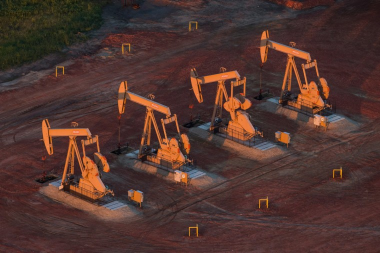 Pumpjacks are seen in an aerial view in the early morning hours of July 30, 2013 near Watford City, North Dakota. (Andrew Burton/Getty Images)