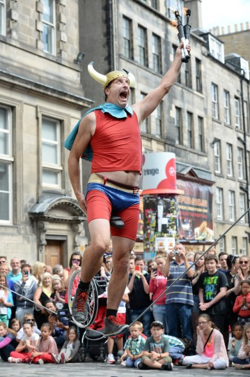 A street entertainer performs on Edinburgh's Royal Mile during the city's Festival Fringe on August 7, 2013 in Edinburgh, Scotland. (Jeff J Mitchell/Getty Images)