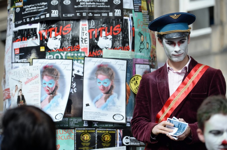 A street entertainer is seen on Edinburgh's Royal Mile during the city's Festival Fringe on August 7, 2013 in Edinburgh, Scotland. (Jeff J Mitchell/Getty Images)