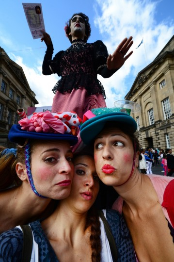 Street entertainers perform on Edinburgh's Royal Mile during the city's Festival Fringe on August 7, 2013 in Edinburgh, Scotland. (Jeff J Mitchell/Getty Images)