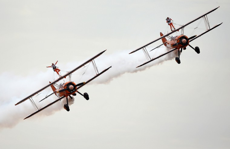 Nine-year-old cousins Rose Brewer and Flame Brewer wingwalk over Rendcomb airfield in Gloucestershire, to become the world's youngest formation wingwalkers in Cirencester, England. The two girls who flew on vintage Boeing Stearman biplanes, were inspired to do so by the plight of Eli Crossley who suffers from Duchenne Muscular Dystrophy. His parents have set up the Duchenne Children's Trust to raise money to research a treatment or cure in time to save Eli's life. (Tim Ireland/Getty Images)