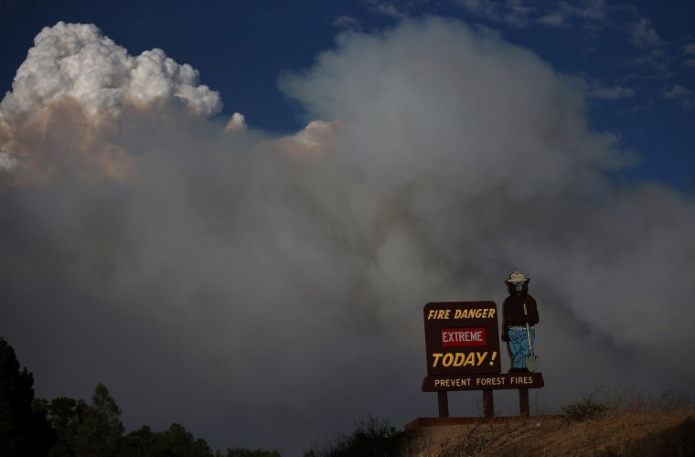 A Smokey the Bear sign is posted along US highway 120 as the Rim Fire burns out of control on August 21, 2013 in Groveland, California. The Rim Fire continues to burn out of control and threatens 2,500 homes outside of Yosemite National Park. Over 400 firefighters are battling the blaze that is only 5 percent contained. (Justin Sullivan/Getty Images)
